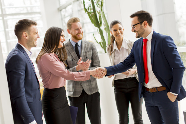 Business partners handshaking after making agreement with employ
