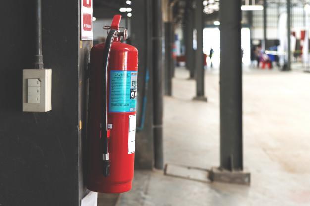 closeup-red-fire-extinguisher_41050-1320