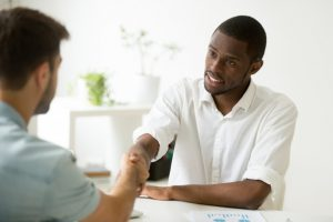 african-american-businessman-handshaking-caucasian-partner-making-deal-starting-meeting_1163-3907
